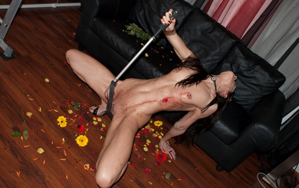 queenslave-whipping-herself